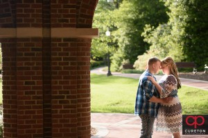 Engaged couple in amazing sunlight during a Clemson engagement session.