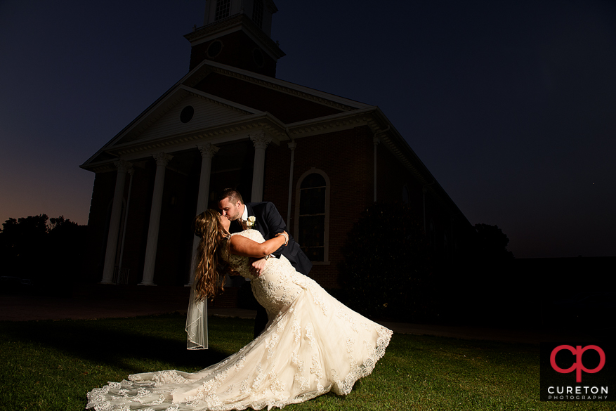 Bride and groom dipping outside of the church after their Cowpens SC wedding at Mountain View Baptist.