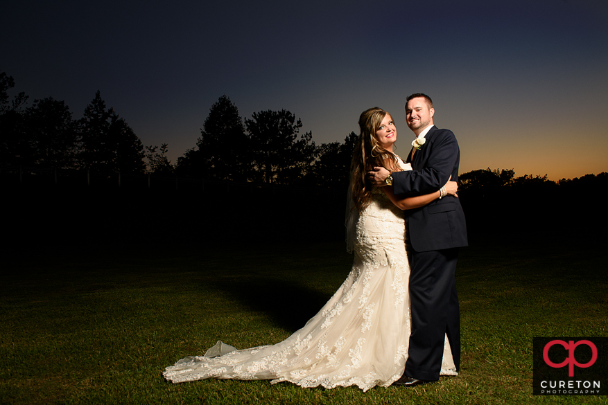 Bride and groom dancing at sunset after their Cowpens SC wedding at Mountain View Baptist..