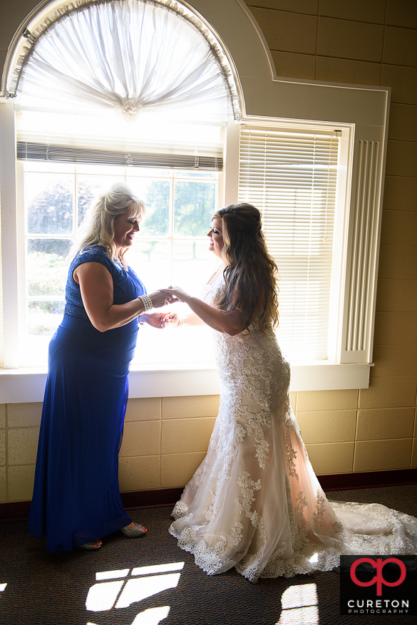 Bride shares a moment with her mother before her wedding.