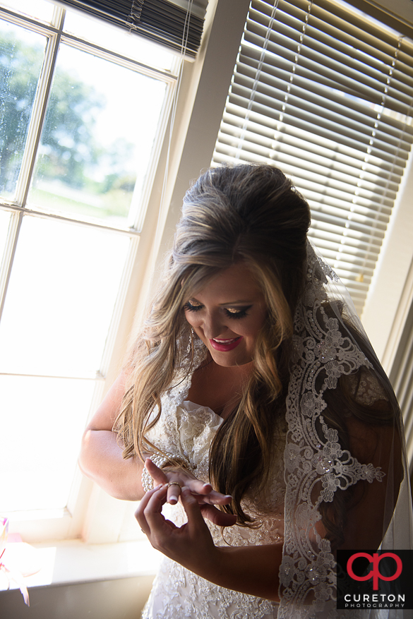 Bride smiling while opening a gift.