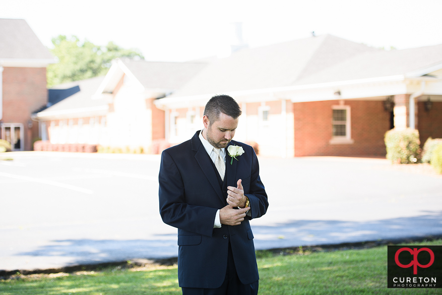 Groom waiting on his bride for their first look.