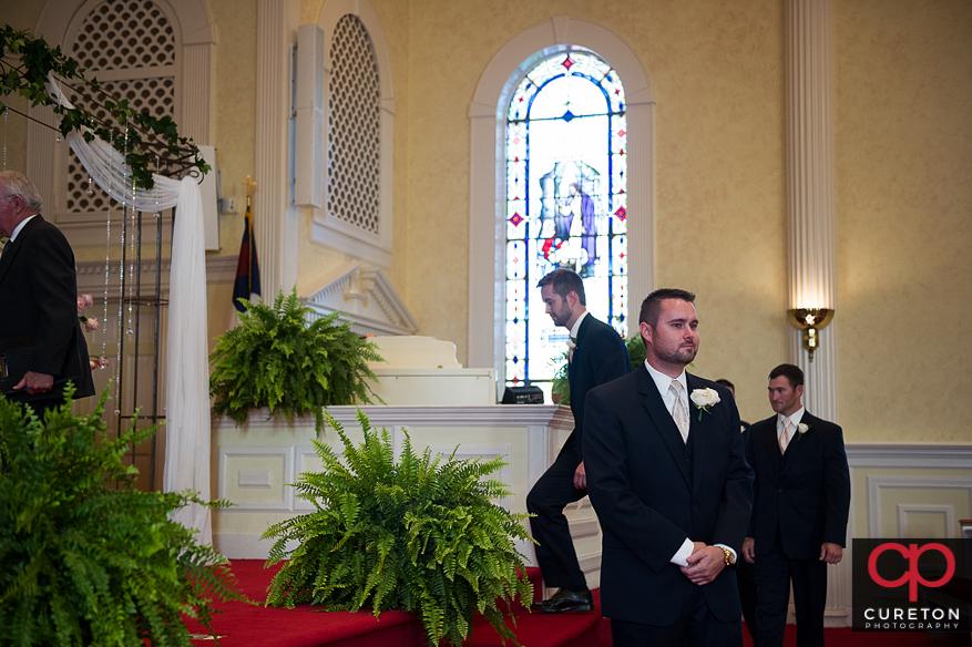 Groom entering the church.