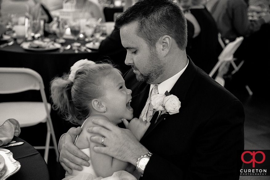 Groom with the flower girl.