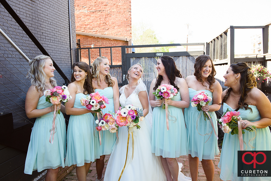 Creative pose for bride and bridesmaids.