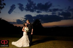 Bride and groom at sunset after their Daniel Chapel wedding.