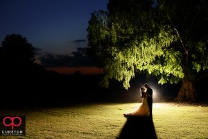 Newly married couple at sunset after their Daniel chapel wedding.