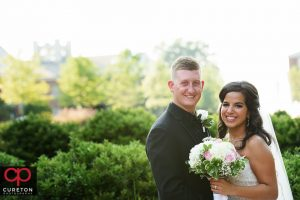 Bride and groom standing outside Daniel chapel.