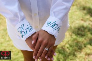 The bride wearing her embroidered shirt before the wedding.
