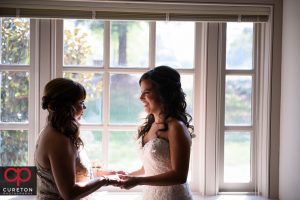 The bride and her mother sharing a moment before the Daniel chapel wedding.