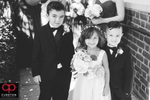 The flower girl standing with the ringbearers outside of Daniel chapel.