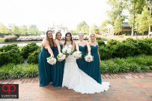 Bridesmaids showing off their flowers outside of Daniel chapel.
