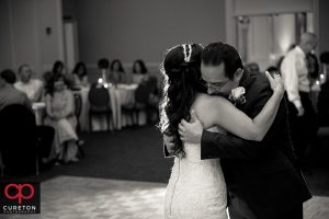 Bride her father hugging after they danced at her wedding reception.