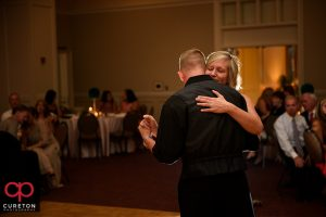 Groom and his mother dancing.