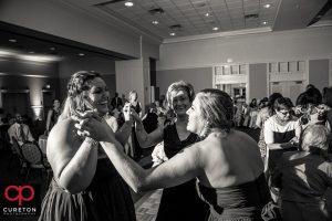 Bridesmaids dancing.