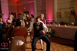 Wedding guest dancing to the sounds of Uptown Entertainment.