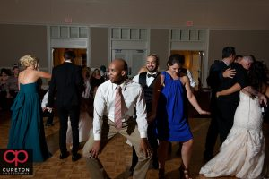 Wedding guest dancing to the sounds of Uptown Entertainment at the Younts Center wedding reception.