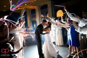 Bride and groom's glow stick leave after their wedding reception at Furman.