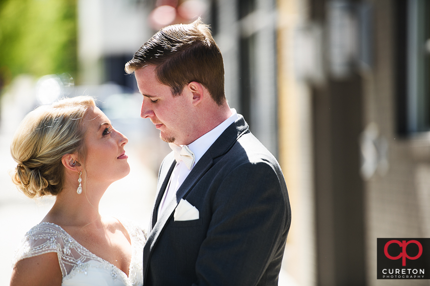 Bride and groom sharing a first look on the streets of downtown Greenville,SC.