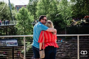 Man preparing to propose to his girlfriend in Falls Park in downtown Greenville,SC.