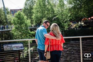 Man walking with his girlfriend in Falls Park in downtown Greenville.