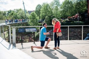 Man gets on one knee and asks for his girlfriend's hand in marriage during a surprise proposal in downtown Greenville ,SC.