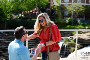 Woman overjoyed that her boyfriend proposed.