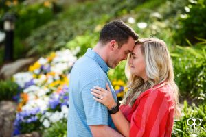 Engaged couple strolling though Falls Park after his surprise proposal.