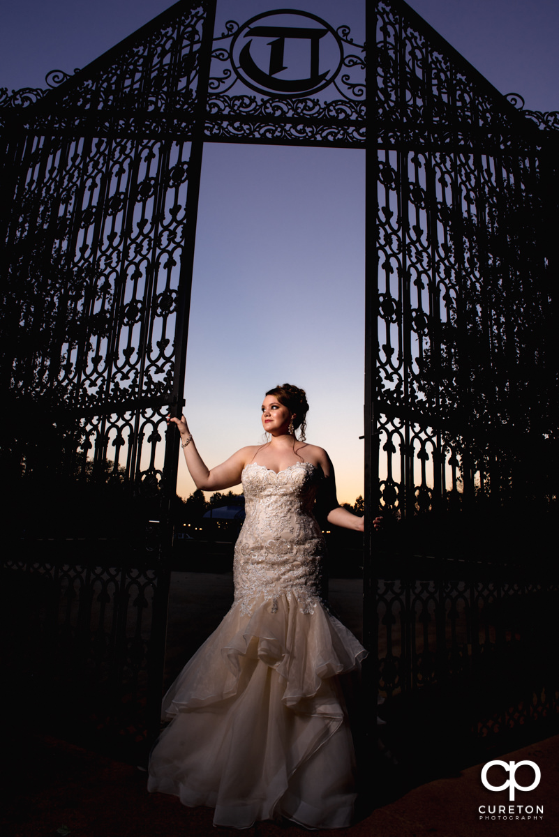 Bride holding the gates at Edinburgh West before her wedding in Taylors ,SC.