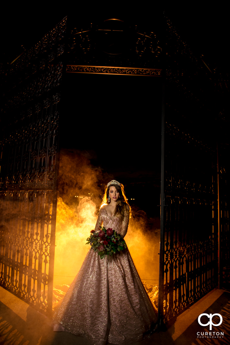Bride holding her bouquet in front of orange smoke at Edinburgh West in Taylors,SC.