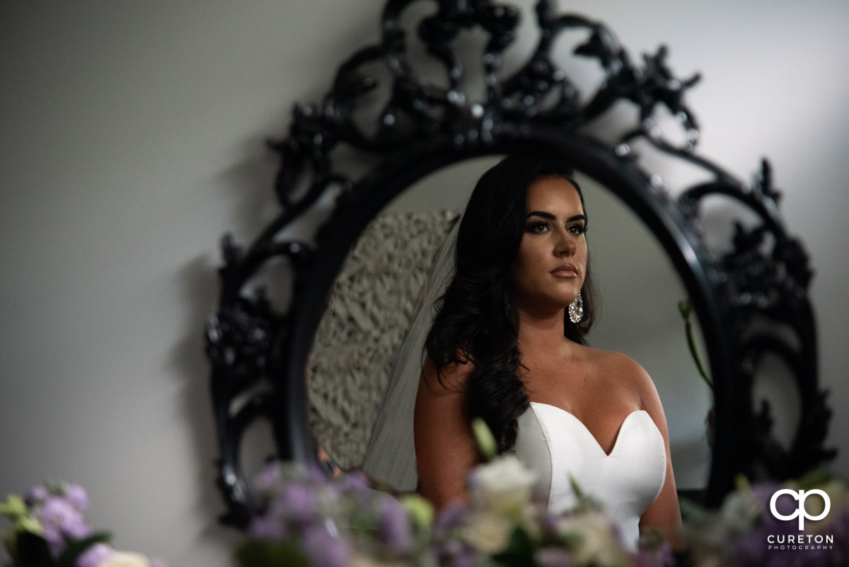 Bride looking into the mirror.