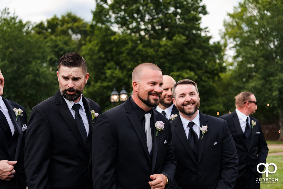 Groomsmen laughing together.