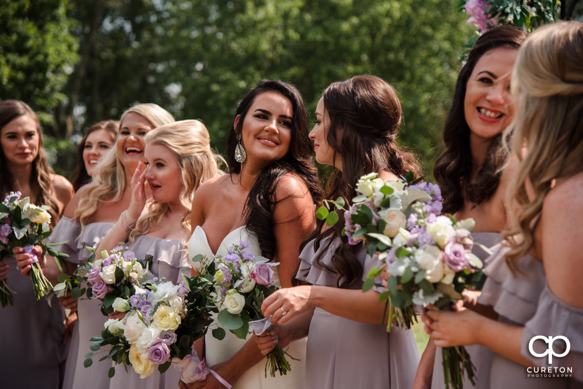 Bridesmaids laughing together.