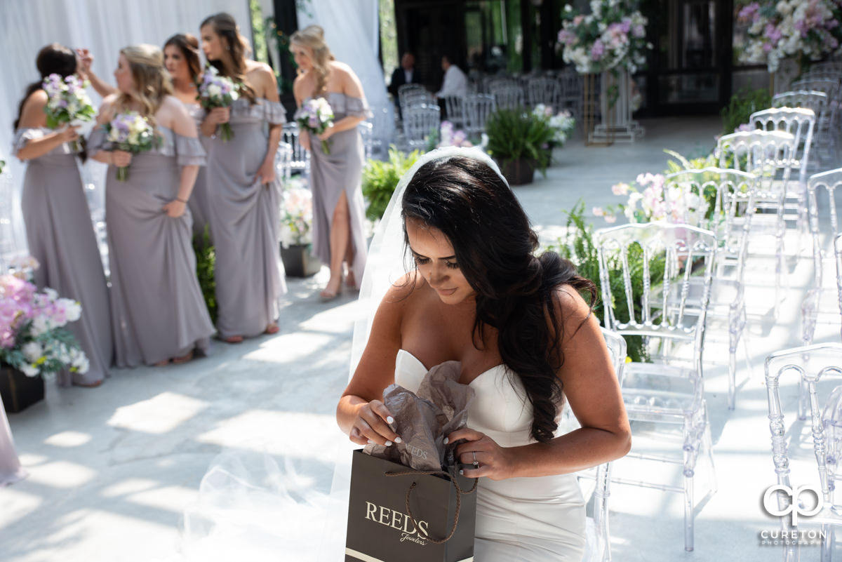 Bride opening a gift.