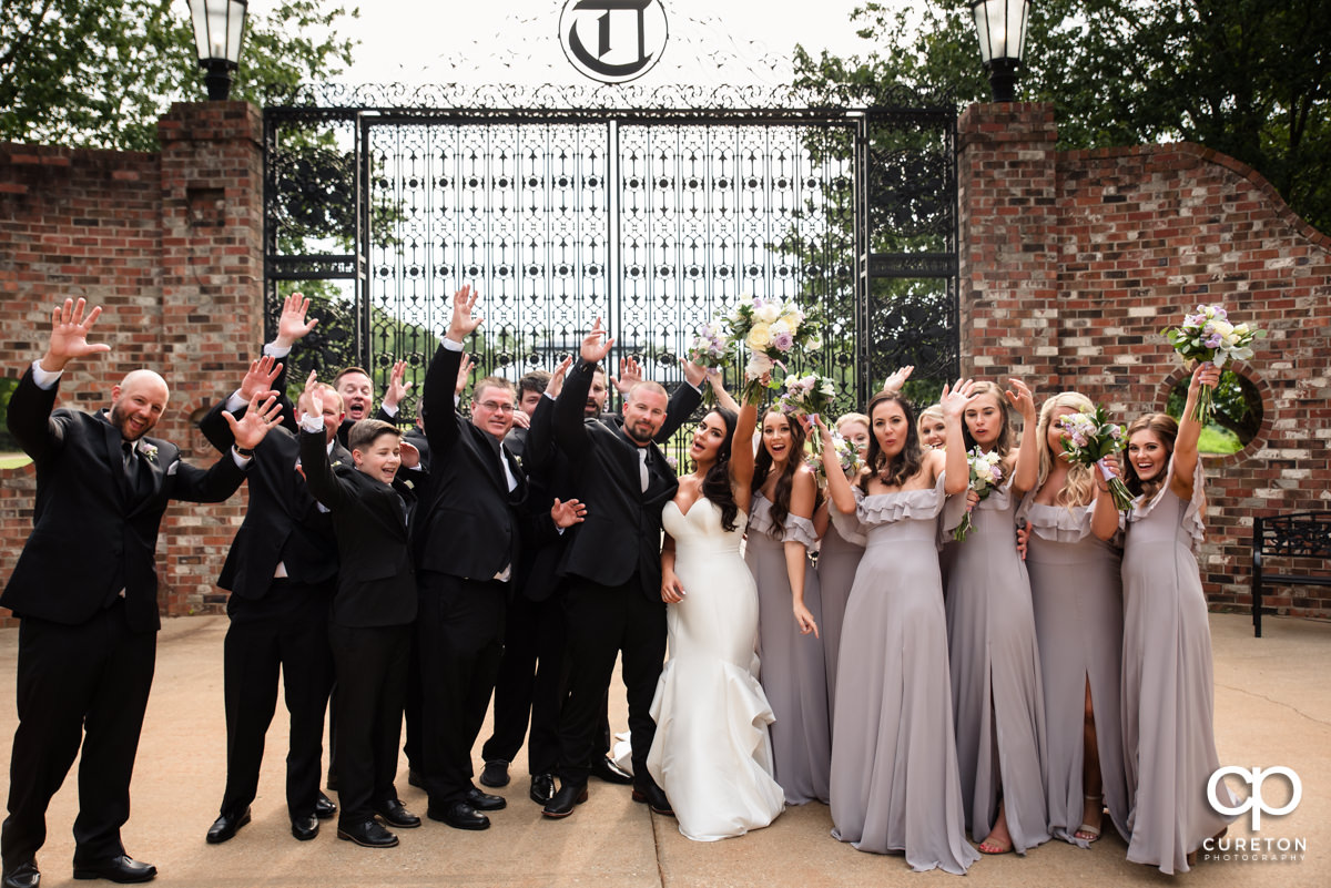 Bridal party cheering.