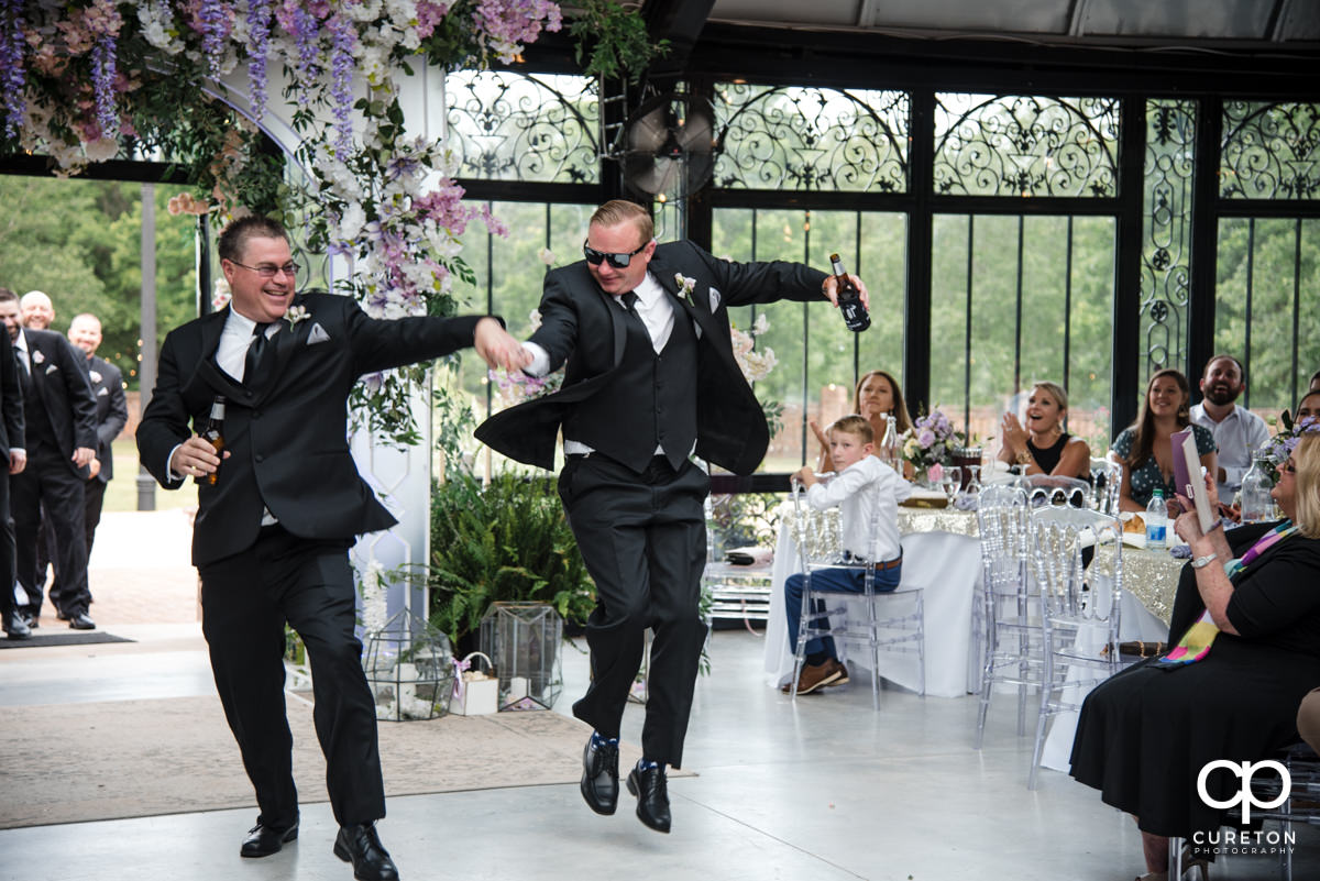 Groomsmen dancing in to the reception.
