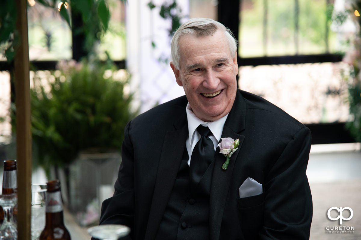 Groom's father.
