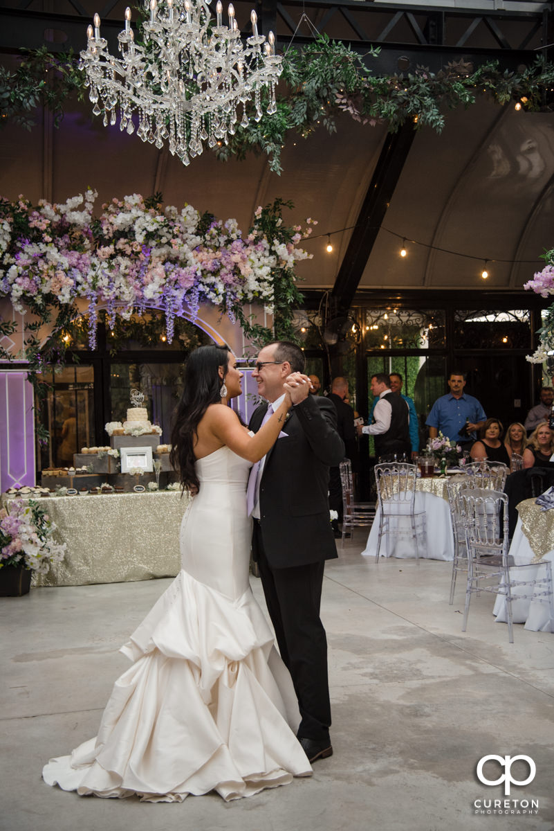 Bride and her father sharing a dance at her wedding reception.