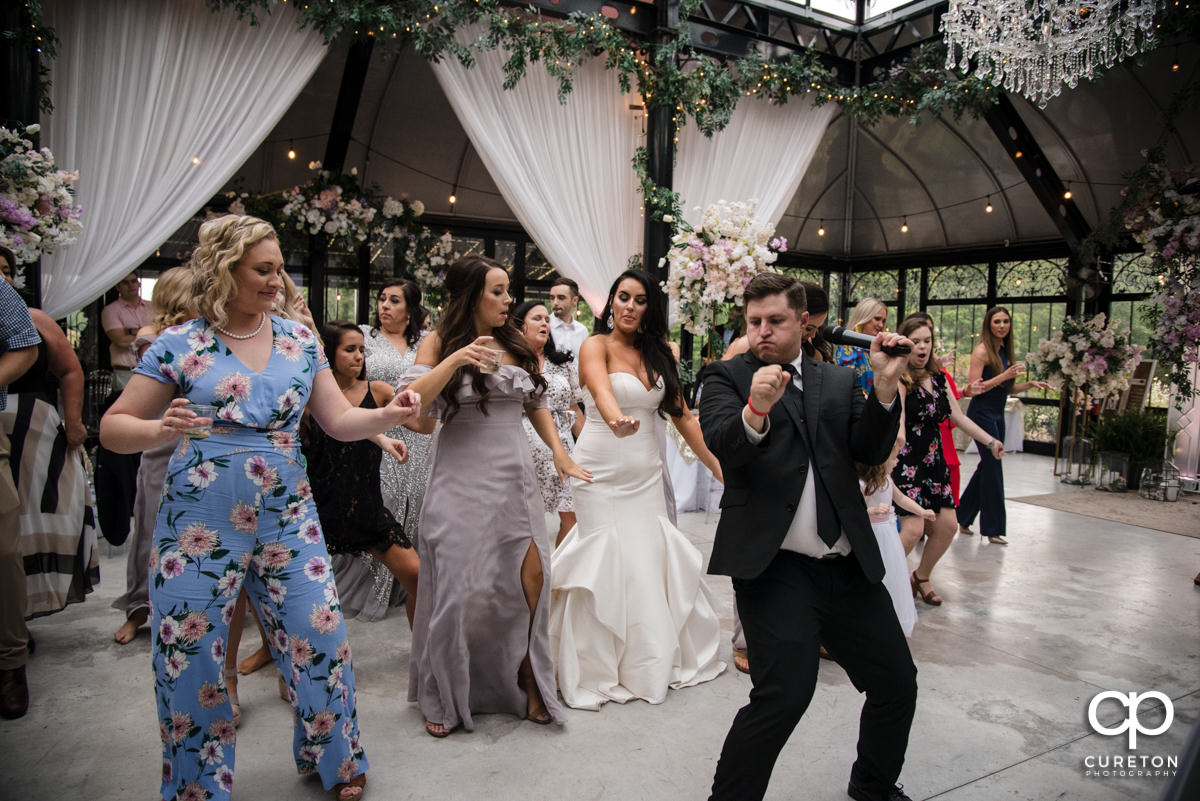 Wedding guests dancing.