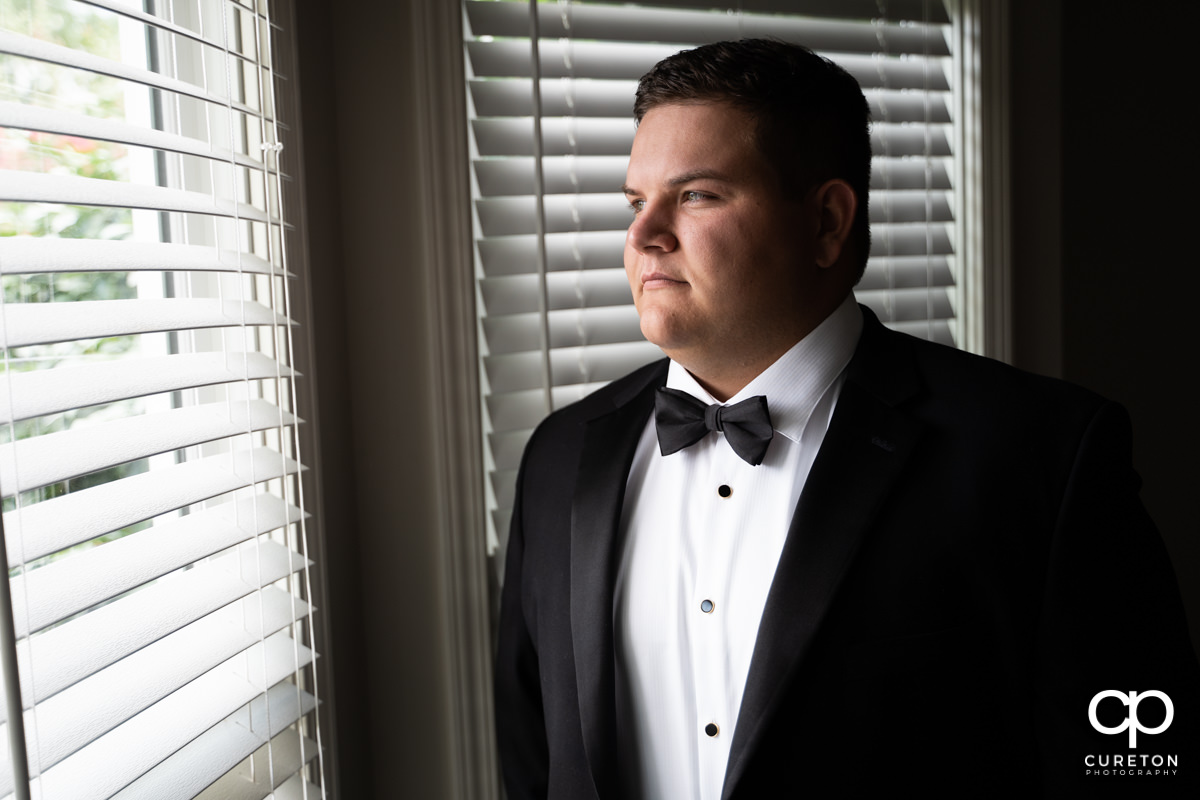 Groom looking out of a window.