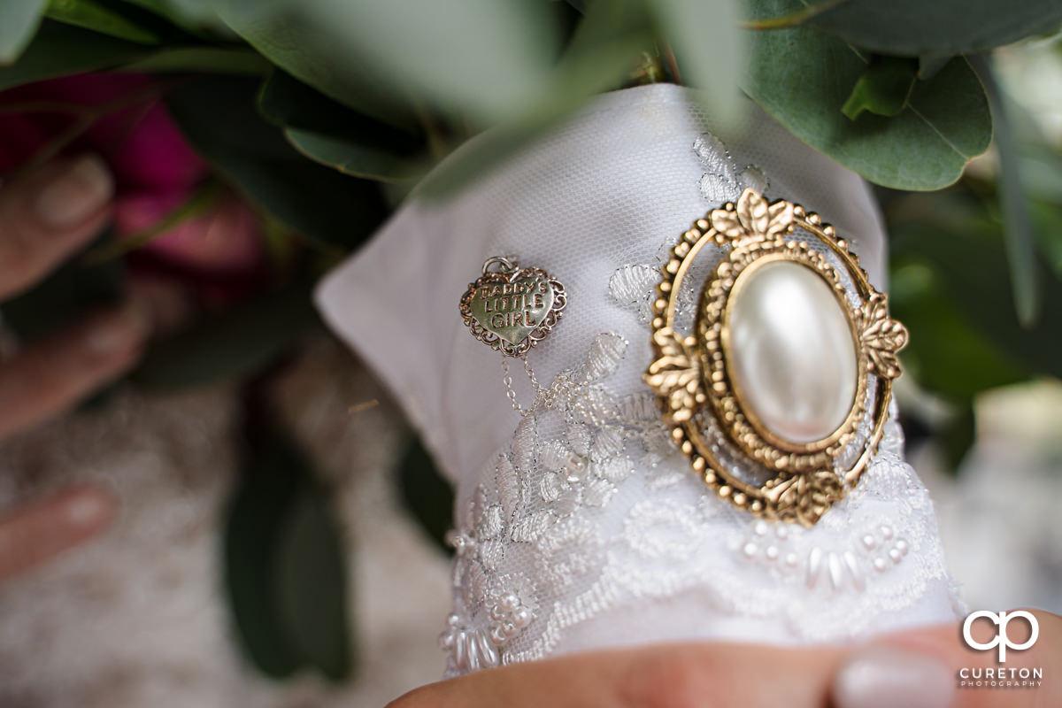 Charm on bride's bouquet.
