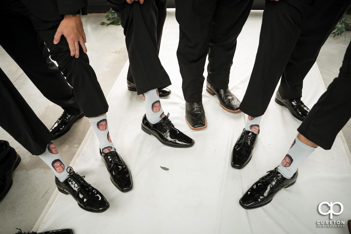 Groom's face on the groomsmen's socks.