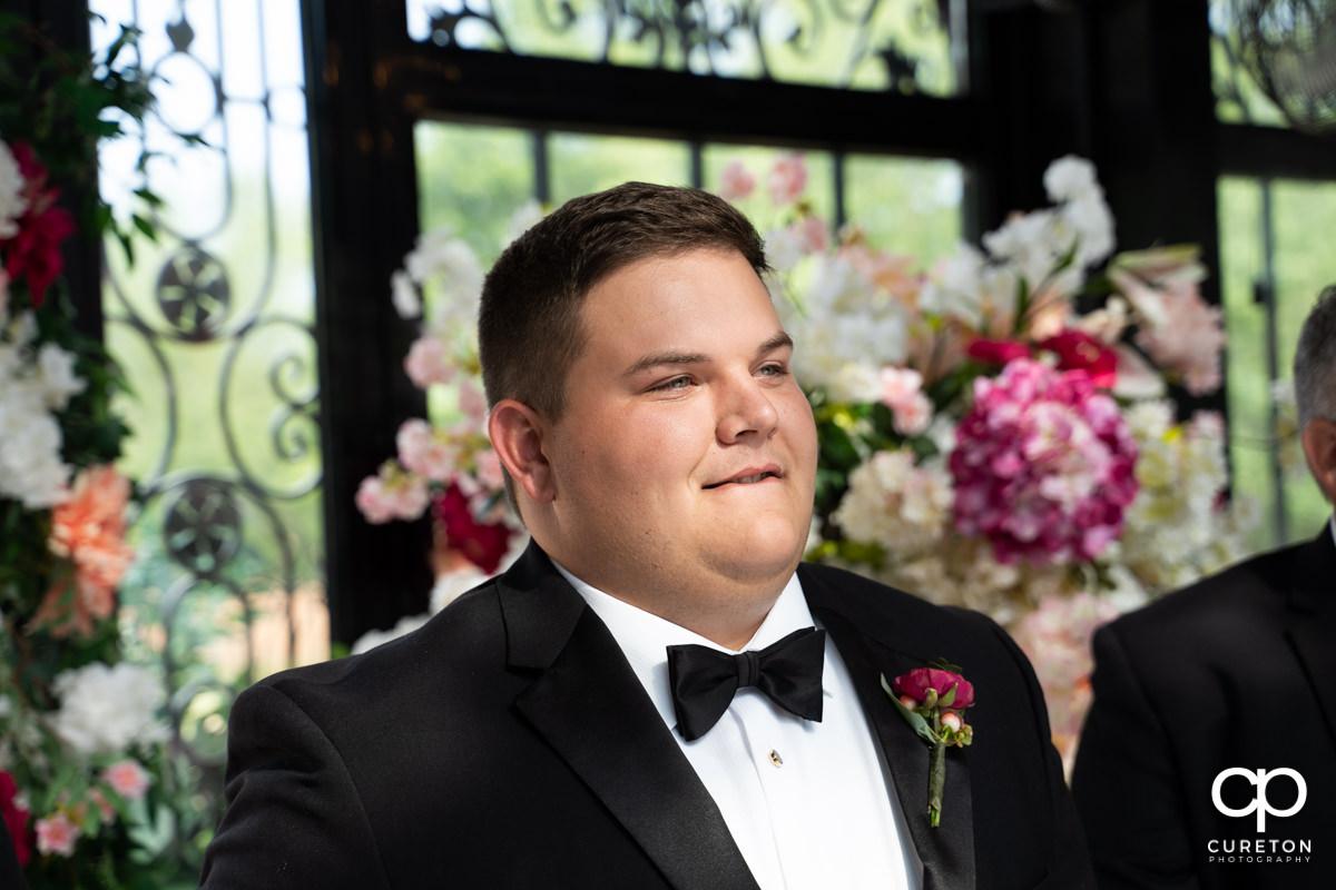 Groom seeing his bride walk down the aisle.