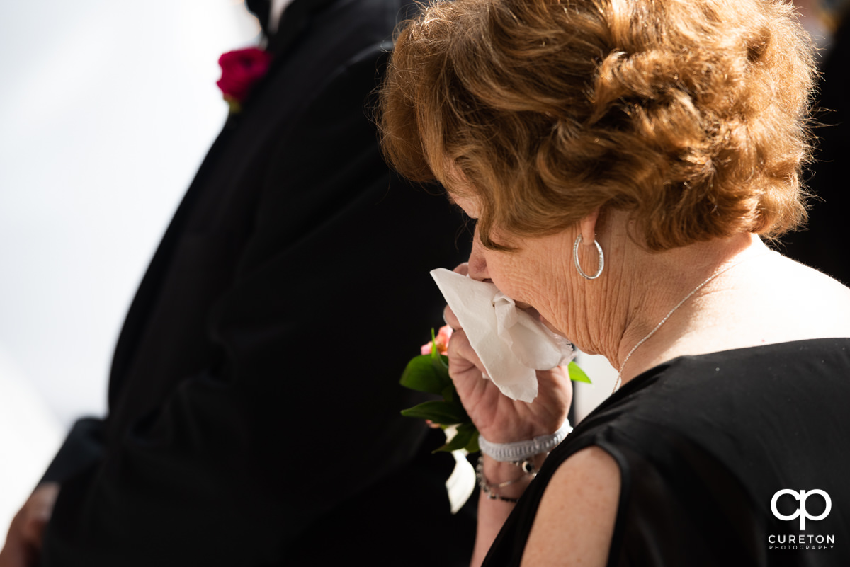 Grandmother crying at the wedding.