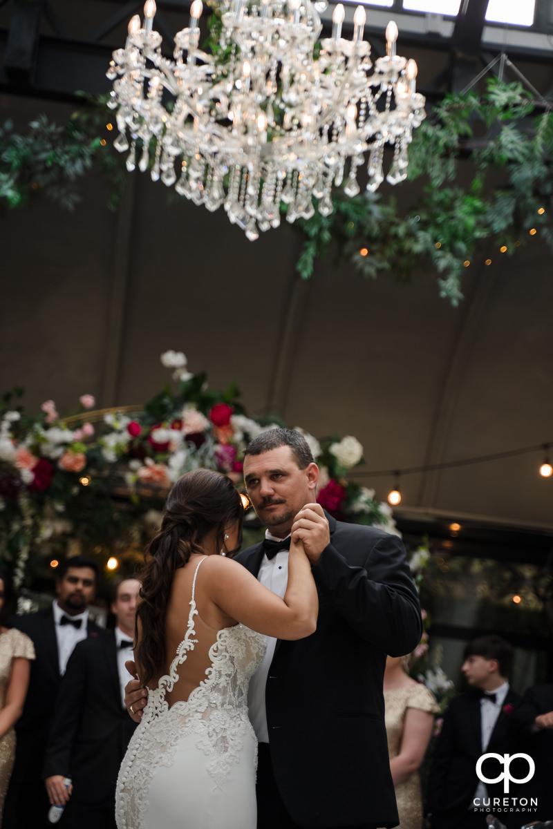 Bride dancing with her stepdad.