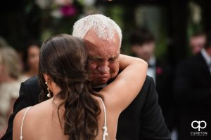 Bride's grandfather crying while dancing with her.