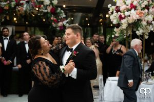 Groom dancing with his mom.
