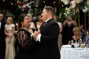 Groom's mother dancing with her son.