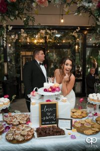 Bride eating a piece of cake.