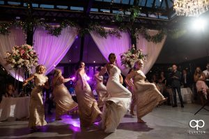 Bridesmaids doing a choreographed dance at the reception.